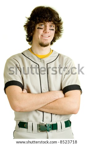 A young male baseball player standing. - stock photo