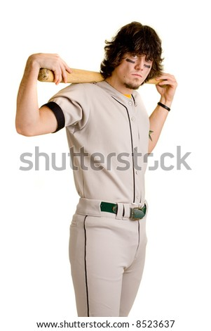 A young male baseball player stretching. - stock photo