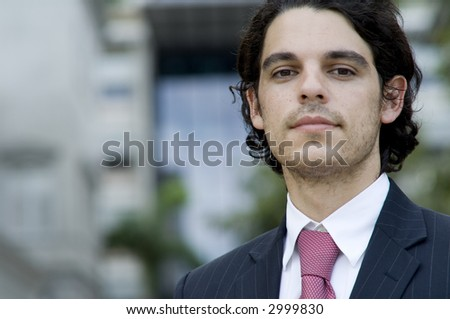 A young male business person outside (shallow depth of field used)