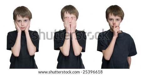 a young male child depicting the three wise monkies old saying hear, see and speak no evil. - stock photo
