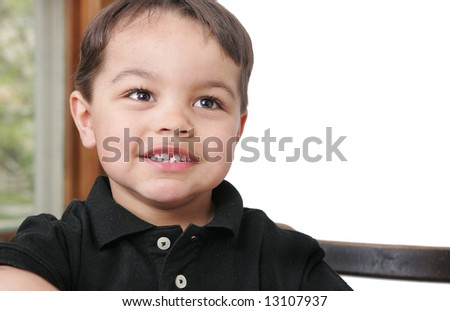 a young male child looking happy and smiling