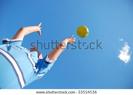 A young male child playing with the ball - stock photo