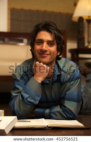 A Young Male Student Smiling - stock photo