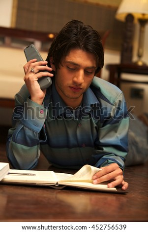 A Young Male Student Studying - stock photo