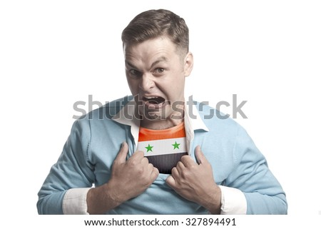 A young man - a patriot: shows the flag of Syria on his chest - stock photo