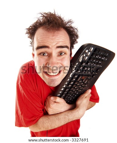 a young man addicted to pc games - stock photo