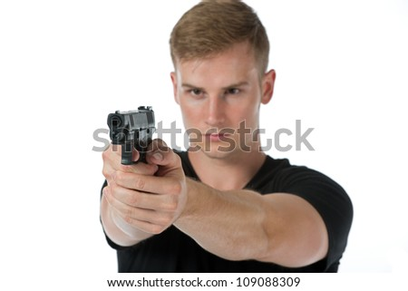 A young man aiming a handgun isolated on a white background