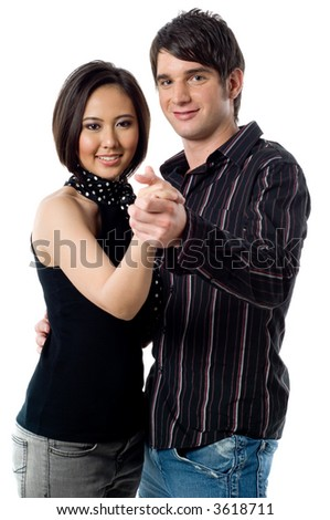 A young man and woman dancing together on white background