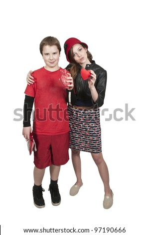 A young man and  woman holding a Valentines Day heart - stock photo
