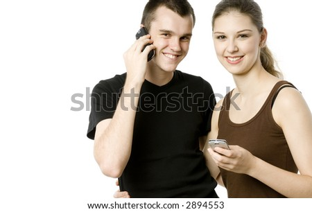 A young man and woman using mobile devices - stock photo