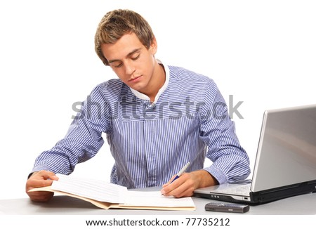 A young man at the workplace - stock photo