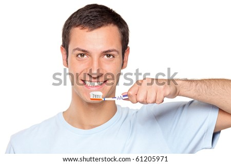 A young man brushing his teeth isolated on white background - stock photo