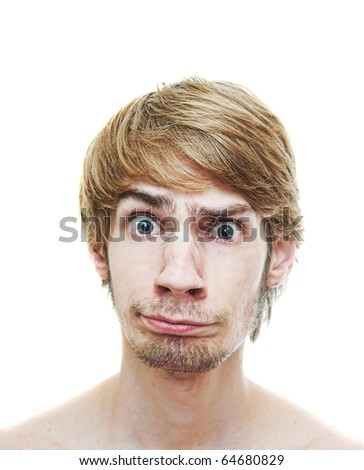 A young man caught in a dilemma looking into the camera with a confused look on his face, isolated on a white background. - stock photo