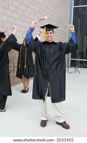 A young man celebrating his graduation holding his diploma - stock photo