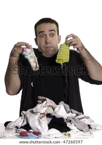 A young man doesn't know how to match socks, isolated against a white background