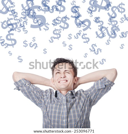 A young man dreams about money - dollar signs - stock photo