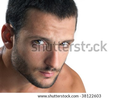 A young man face staring at camera isolated on white background - stock photo