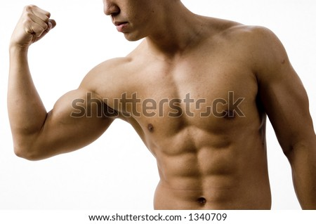 A young man flexes his bicep - stock photo