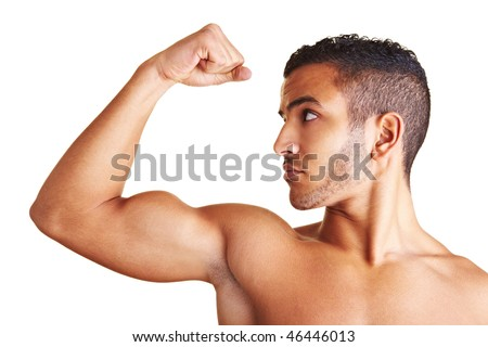 A young man flexing his biceps muscles - stock photo