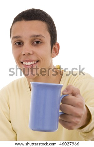 A young man giving you a blue coffee mug