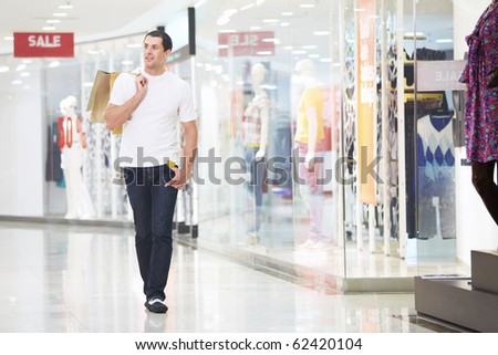 A young man goes shopping with the store - stock photo