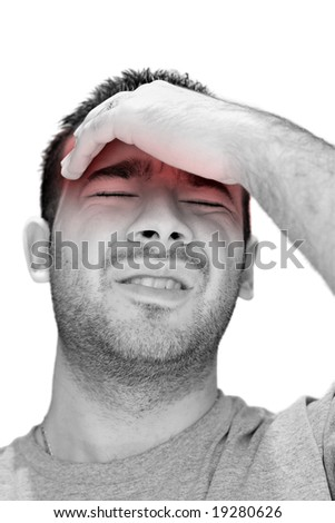 A young man grasping his head where the pain is - a killer headache or migraine. - stock photo