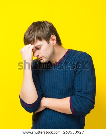 a young man his hand on the head of the stress - stock photo