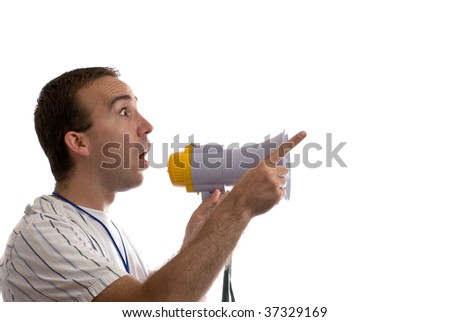 A young man holding a blowhorn and pointing at white copyspace - stock photo