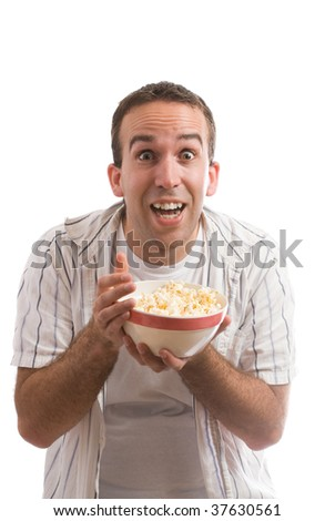 A young man holding a bowl of popcorn and watching a movie, isolated against a white background
