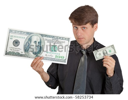 A young man holding a large and small money on white - stock photo
