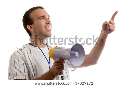 A young man holding a megaphone and pointing at white copyspace - stock photo