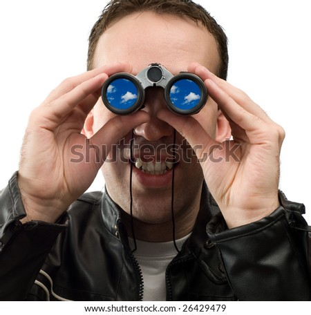 A young man holding a pair of binoculars is watching the clouds, isolated against a white background - stock photo