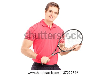 A young man holding a tennis racket isolated on white background - stock photo