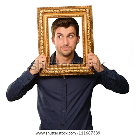 A Young Man Holding And Looking Through Frame On White Background - stock photo
