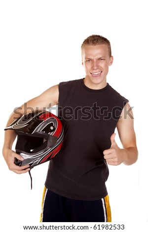 A young man holding his motorcycle helmet showing how  excited he is  to go and ride.