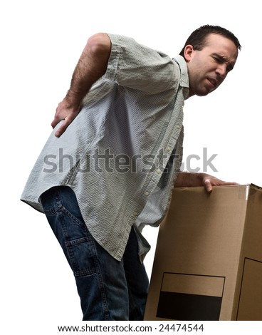 A young man holding his sore back, isolated against a white background - stock photo
