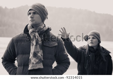 A Young Man Ignoring He's Girlfriend After A Fight - stock photo