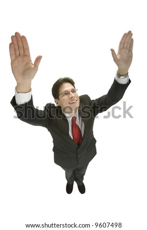 A young man in a black business suit with his hands raised over his head. - stock photo