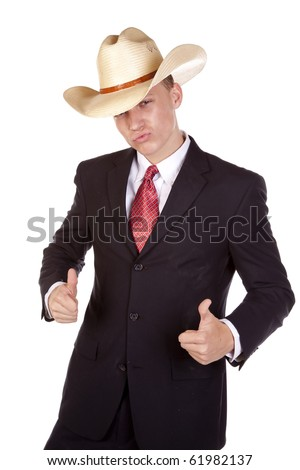 a young man in a cowboy hat and suit showing his funny side by putting his thumbs up.