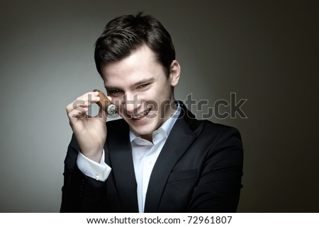 A young man in a happy mood celebrating something - stock photo