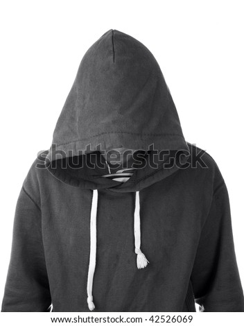 A young man in a hoodie with face hidden - stock photo