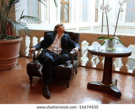 a young man in a luxury room of hotel - stock photo