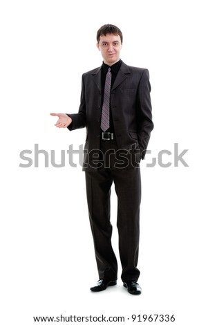 A young man in a suit shows his hand to the side, isolated on a white background. - stock photo