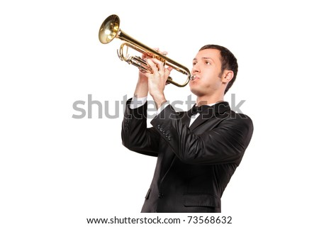A young man in black suit playing a trumpet isolated on white background