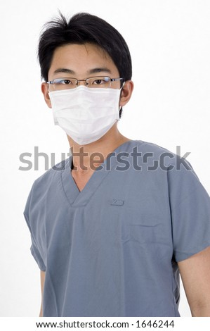 A young man in medical scrubs