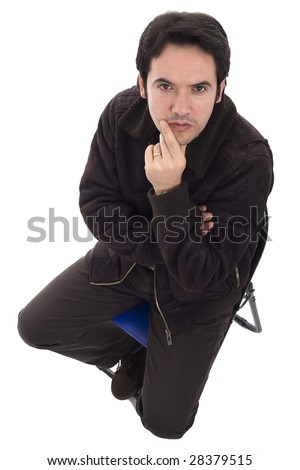 A young man is thinking with is hand on the face - stock photo