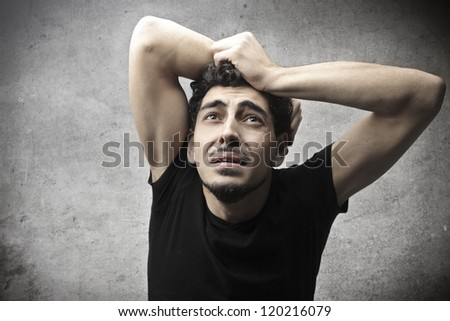 A young man is threatened by someone - stock photo