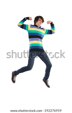 A young man jumping in the air and flexing muscles. Full length studio shot isolated on white. - stock photo