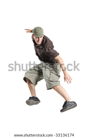 A young man jumping in the air isolated on a white background - stock photo