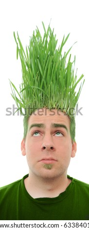 A young man looking upward at the grass growing from the roots on top of his head. This concept can apply to environmentalists, farmers, agriculture, landscapists, gardeners, and crazy haircuts. - stock photo